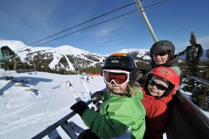 Family in ski lift chair
