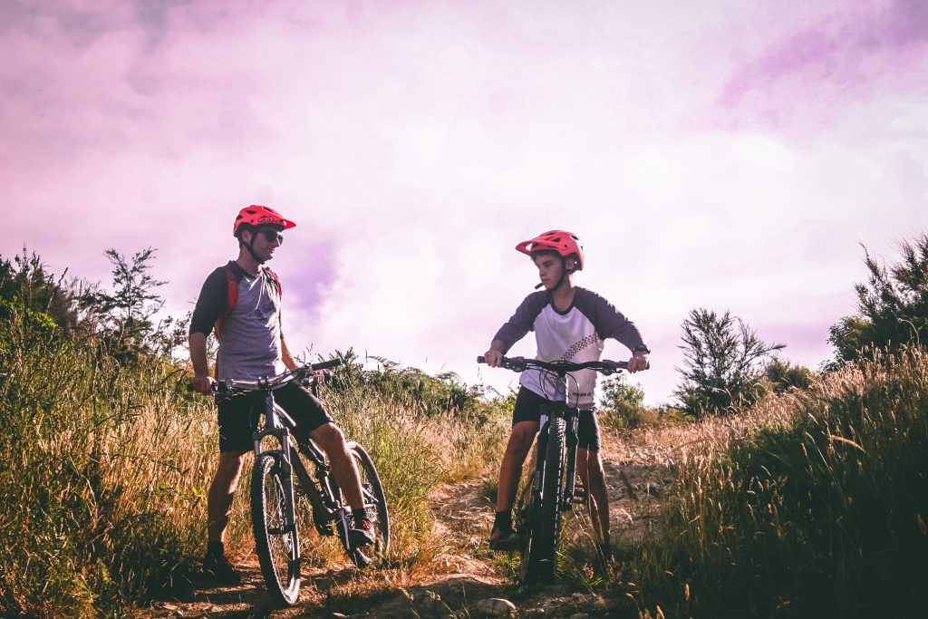 Father and son mountain biking in the mountains